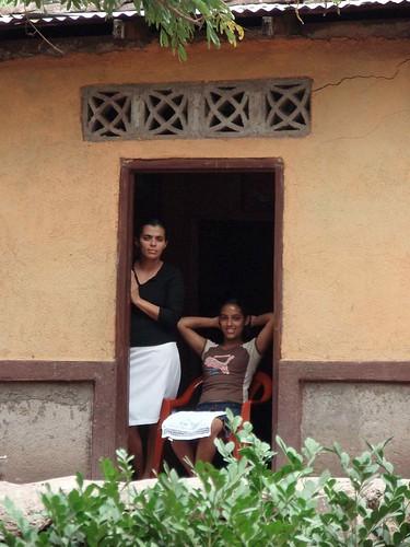 Two women in the doorway - Dos mujeres en la puerta; Aldea El Bramadero, Estelí, Nicaragua
