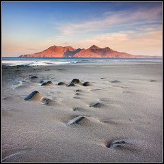 Eiggy sunrise (Ally Mac) Tags: sea orange sun mountains sunrise canon landscape dawn bay scotland sand rocks innerhebrides scottish lee rum isle squarecrop goldenhour 1022 cpl firstlight rhum eigg laig smallisles 40d
