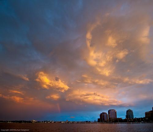 Wispy amber clouds