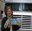 Jennifer Brunner in front of The Courage Express