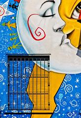 a planetary love (Ezio Beschi) Tags: street blue red sun moon white house black milan art window colors yellow casa kiss blu milano luna finestra giallo sole rosso colori bianco nero bacio mygearandme