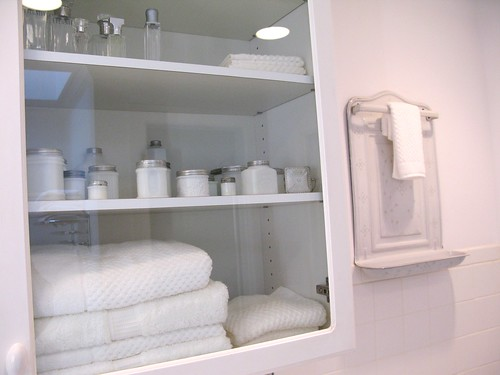 Simple milk white in bathroom cabinet, via Flickr: Sunshinsyrie