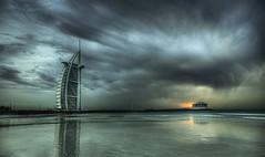 After the storm (momentaryawe.com) Tags: sunset sea storm beach water clouds hotel sand dubai uae emirates burjalarab hdr d300 momentaryawe