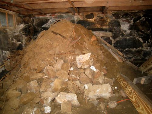 Pile of Dirt in Back Basement