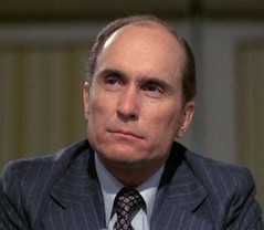 Robert Duvall as the network corporate guy, Frank Hackett