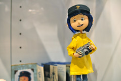 Coraline with a camera (Bruce Levenstein) Tags: camera yellow doll sandiego puppet raincoat comiccon neilgaiman stopmotion sdcc coraline neca sigma30mmf14 henryselick sdcc09 sdcc2009