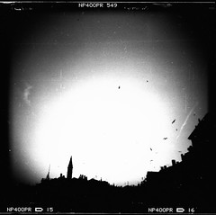 Final Sunset in Rovinj (Rolf F.) Tags: camera old city sunset urban blackandwhite bw sun building bird tower 120 film church monochrome birds silhouette architecture backlight analog canon mediumformat toy evening town holga interestingness interesting fuji kodak roman stock n croatia scan d76 plastic explore 400 fujifilm neopan analogue expired rovigno rovinj canoscan istria hrvatska 120n stamm istra holga120cfn kroatien 8800 cfn istrien 8800f fujifilmneopan400 autaut