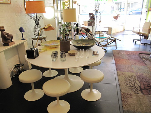 Killer vintage Saarinen tulip table and stools at a  La Mod on Palm Canyon