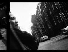 Cristina Between Frames (trittium) Tags: leica nyc bw white black film rangefinder apx100 diafine 100 agfa range finder m2 apx leitz