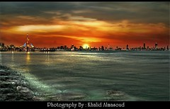 City in Silhouette time (khalid almasoud) Tags: city sunset sea seascape silhouette marina canon eos rocks waves cityscape photographer view time front kuwait khalid kuwaiti         400d almasoud
