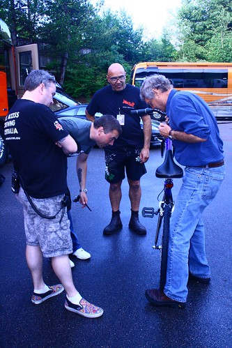 David demonstrates just how easily one can fold up the Montague CX bike, as the others watch and learn.