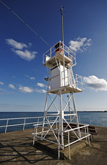 The Lighthouse at Gorey Harbour (s0ulsurfing) Tags: ocean light shadow red sea sky cloud sunlight lighthouse seascape tower beach water lines weather clouds contrast island bay coast pier lighthouses skies shadows bright harbour pov cove wide perspective shoreline fluffy wideangle atlantic pointofview coastal shore cumulus jersey coastline lantern nautical humilis isle atlanticocean 2009 navigation skeletal nube gorey bold meteorology hmb nephology montorgueil 10mm sigma1020 s0ulsurfing cumulushumilis aplusphoto coastuk bayofstmalo