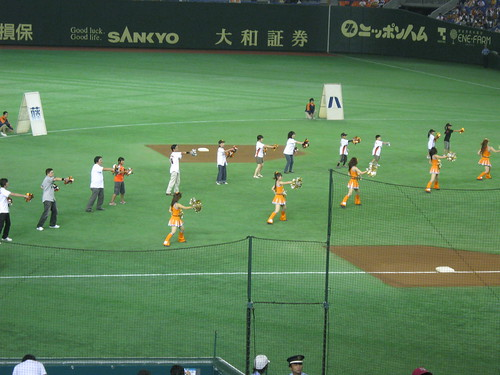The cheerleaders and the fans doing their routine.