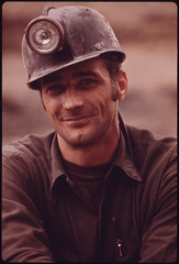 One of a Series of Portraits of Miners Waiting to Go to Work on the 4 P.M. to Midnight Shift at the Virginia-Pocahontas Coal Company Mine #4 near Richlands, Virginia 04/1974 (The U.S. National Archives) Tags: hardhat portrait man mine handsome coal miner coalminer environmentalprotectionagency coalmining richlands tazewellcounty documerica usnationalarchives nara:arcid=556343