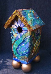 The Freedom of all Flying Things: Joni's Birdhouse (sucra88) Tags: blue green glass gold pc handmade mosaic mixedmedia circles birdhouse polymerclay donation jonimitchell premo millefiore ornamentalbirdhouse susancrocenzi wwwscmosaicscom forthebirdsauction neighborhoodcenterforthearts