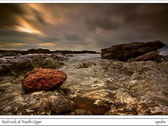 Red rock at Traeth Ogwr (opobs) Tags: sunset sky beach water southwales wales river seaside sand october 2009 gitzo ogmore valeofglamorgan bridgend rockpool anglefinder ogmorebysea riverogmore 1740mml wetknees ogmorebeach opobs cokinxpro traethogwr michaeljstokesawpf canon5dbroken