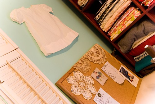 to-do board with great-great aunt's doily and thrifted baby dress