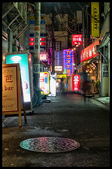 Shimo-Kitazawa at night (Eric Flexyourhead) Tags: street red people signs motion yellow japan night lights tokyo movement neon purple   colourful setagaya shimokitazawa   zd olympuse500 1445mm