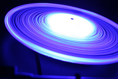 Turntable Trails // Thorens td-316 (Audiotribe) Tags: longexposure pink blue light abstract color colors electric digital canon eos lampe licht exposure glow colours purple snake lumire turquoise spin echo vinyl trails experiment led trail spinning ortofon trippy lys orbit eyecandy thorens 12inch 45rpm 33rpm diode cahaya svjetlo bl ligero ljus otw ledlight slange eos400d  ledlicht exposureeffect thorenstd316 lysspor ortofonnightclub