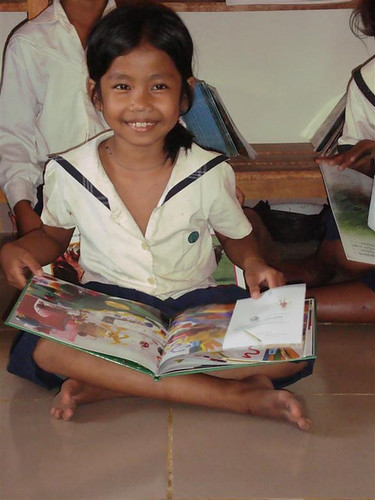 A student reads her favorite book.