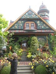 Nob Hill House (AGA~mum) Tags: nancy sunflowers turret carvings paintedlady victorianhome ornategates latinphrase theinspirationalgarden queenannehillseattle nobhillinseattle quoampliuseoamplius