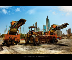 we built this city [HDR] - constructicons! (alvin lamucho ) Tags: city urban wheel clouds cat truck buildings this mercedes sand cityscape angle caterpillar soil transformers highrise paving builders trucks machines hdr komatsu bulldozer built tonka develop skyrise developing city dozers hauler bigtoys payloader excavators constructicons canon cold middle rebel we east wide kuwait industrial effect alvin track 450d xsi material nortrac planer loader handlers lamucho