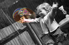 Mia and the Bubble (StuartWebster) Tags: bw smile sunshine photoshop d50 garden happy 50mm iso200 nikon raw daughter bubbles mia laughter f18 southampton 13200sec elements7