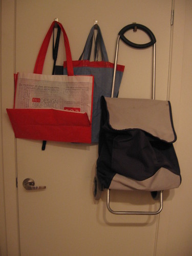 Bag and basket station on hooks behind the door