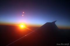 Sunset (Nux Pix (Home Treating a Tough Knee Injury)) Tags: blue sunset sun plane canon dark airplane rebel flying pix dusk horizon carribean jamaica airline airbus flare 2009 a320 xsi airbus320 usa3000 nux 450d starburtst
