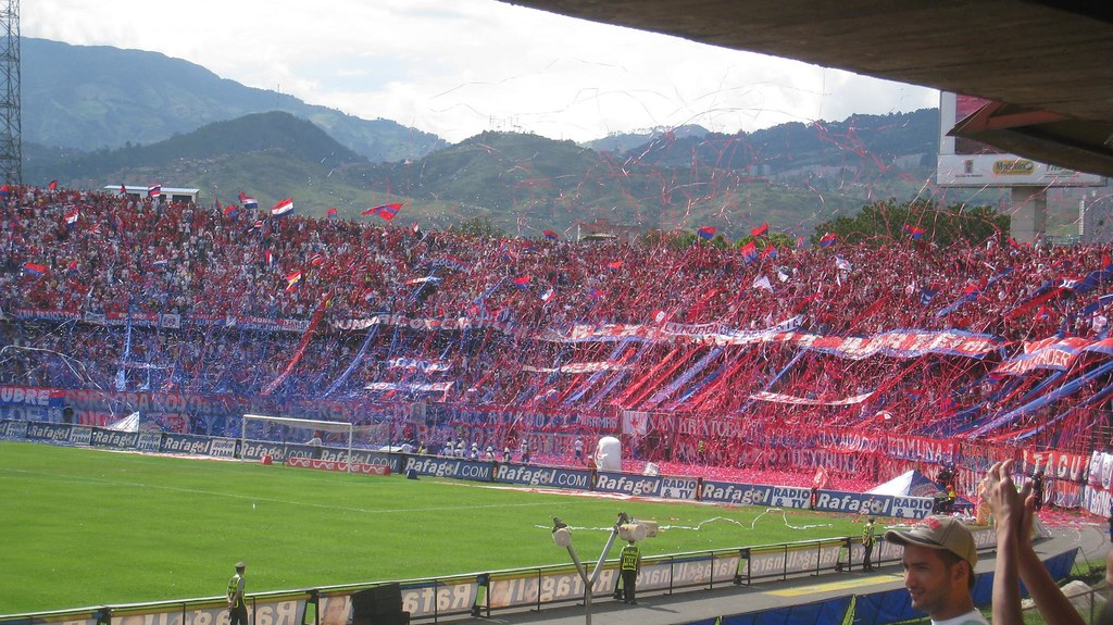 Fans of Independiente Medellin, one of the cities two soccer teams, go wild in the stands.
