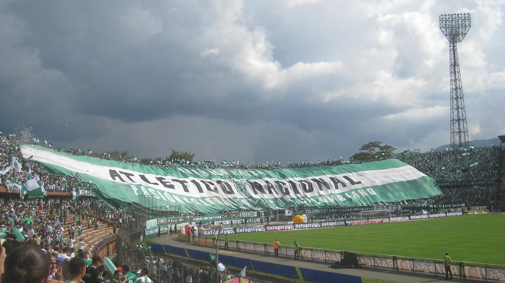 The fans of Atletico Nacional, one of Medellin's two professional teams, unfurl a massive banner before the game starts.