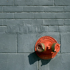 Three Red Dots (red_dotdesign) Tags: red texture wall contrast hydrant fire grey pattern minimal sprinkler cinderblockwall