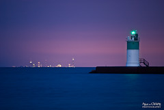 City on the otherside (aliveandclickin) Tags: lighthouse chicago skyline pier illinois interestingness downtown nightscape dusk searstower lakemichigan explore waukegan johnhancocktower explored krishlikesit northbeachpark