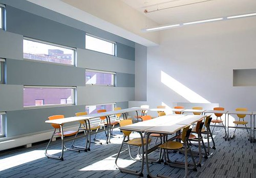 The fenestration of the East Harlem School was designed to let in ample daylight while creating a sheltered environment for the students. (Courtesy www.freelandarch.com)