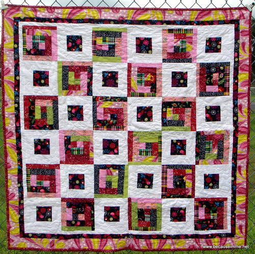bird on black fabric quilt