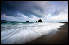 Flow in to tomorrow (Mark Emirali) Tags: ocean longexposure light sea newzealand sky cloud seascape colour beach nature water clouds canon landscape flow sand mood auckland nz westcoast frontpage 1022mm 30d waterflow copyrighted whatipu canon30d pleasedonotusewithoutmypermission maloe4 maloephoto maloephotography markemirali