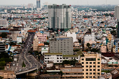Must I Dream and Always See Your Face (Neil Ta | I am Bidong) Tags: rooftop skyline southeastasia cityscape vietnam urbanexploration canon5d saigon hochiminhcity urbex heavytraffic sunwah district1 nguyenhue canon135mm rooftopping neilta june2011 iambidong