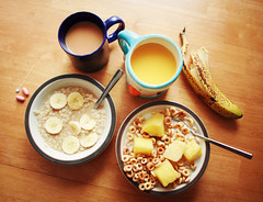 Breakfast For Two (Simply Stardust) Tags: breakfast warm tea banana oatmeal delicious mango orangejuice bowls vitamins spoons earlgrey coffeemugs woodtable penguinmug breakfastfortwo ofmornings wholewheatcheerios