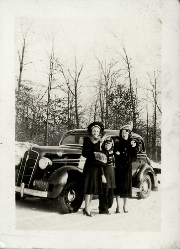 two women, one child and car