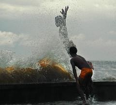 kids, splash, waves...series 2 (Bosso Baron) Tags: water kids waves philippines manila splash slum breakwater yonzon tondo topcatrucker