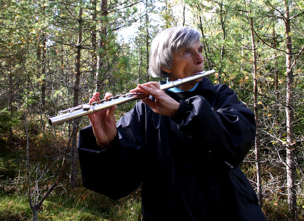 The Flute Player in the Forest