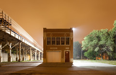 Commercial Building with L II (metroblossom) Tags: sky orange usa chicago building night train illinois tracks el study commercial l southside firehouse isolated renovated img9855