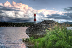 Lighthouse Revisited (Philerooski) Tags: trees houses light red sky lighthouse white house lake mountains water grass rock clouds contrast canon washington big perfect waves shoreline large hills cattails shore huge wa ripples hdr diamondlake philerooski