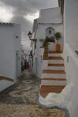 Calles de Frigiliana (Oscar Garca) Tags: street espaa white house blanco stone stairs town casa calle andaluca spain cloudy pueblo cal nublado lime escaleras mlaga piedra frigiliana