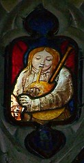 Bagpiping angel (robin.croft) Tags: angel stainedglass medieval bagpipes fairford angemusicien