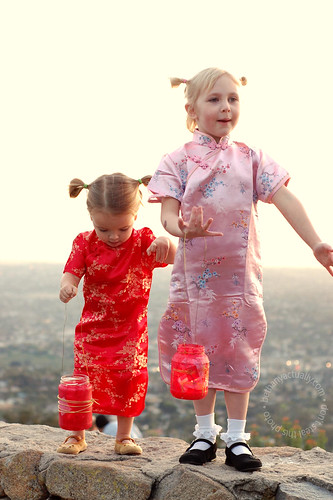 kids + glass lanterns + fire + standing on a wall...