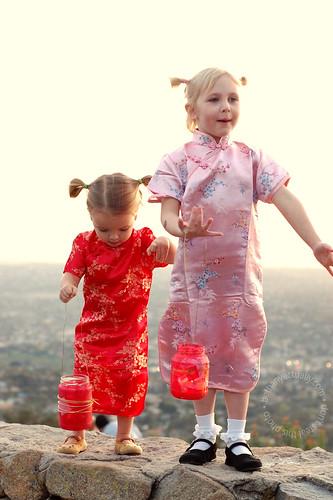 kids + glass lanterns + fire + standing on a wall...
