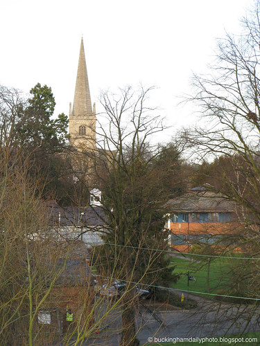 the spire seen through tree branches.