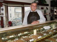 Franklin Di Vilio stands by his handmade chocolate candies, sold by the pound. ~photo Michael Timm