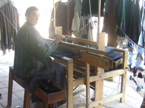 A lady at her loom
